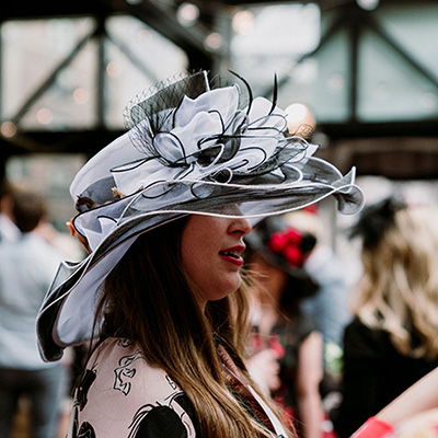 Woman at Derby Party wearing large Hat